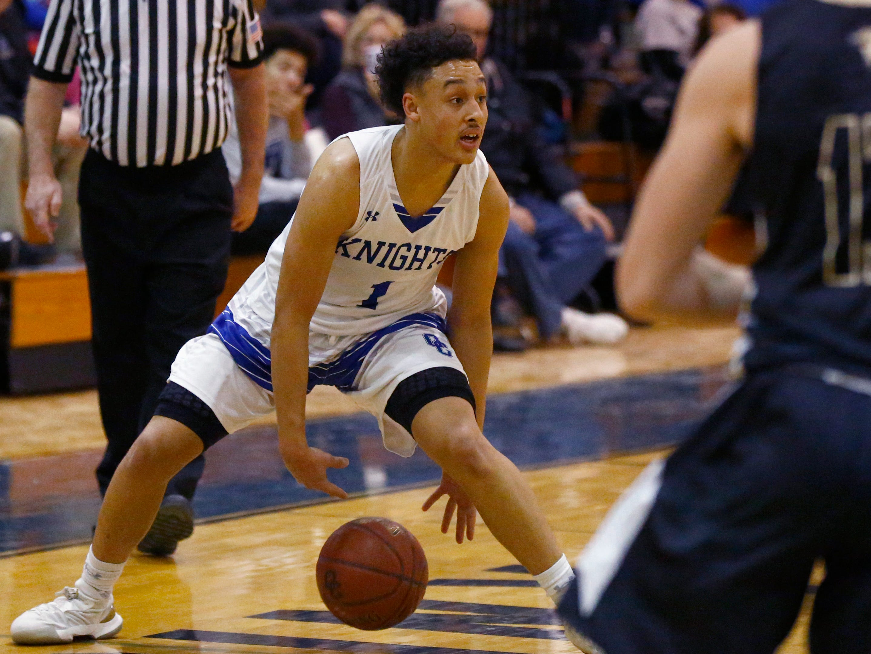 Oak Creek's Quinn Stulo eyes down his opponent in the Knights' game against Franklin on Jan. 25.