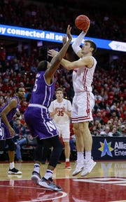 Wisconsin's Ethan Happ shoots over Northwestern's Dererk Pardon on his way to a triple-double (13 points, 12 rebounds and 11 assists) Saturday at the Kohl Center.