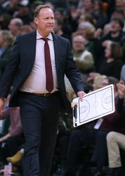 Bucks head coach Mike Budenholzer has his board out to diagram a play during a timeout against the Hornets Friday night.