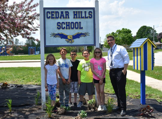 Cedar Hills Elementary School in Oak Creek is one of eight schools in the state to be nominated for the National Blue Ribbon Schools Program. Shown at the school's 2018 Spruce Up Cedar Hills landscaping project are (from left) students Kaylee Budde, Gavin Granillo, Juan Garcia, Jonathan Grzybowski, Emma Polzin and principal Keith Ruffolo.