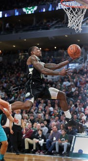 Bucks guard Eric Bledsoe floats to the basket for a layup against the Hornets on Friday night.