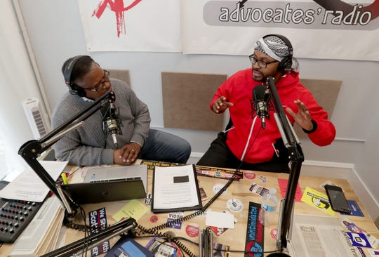 Earl Ingram Jr. (left) broadcasts his radio show with his guest, Ramel Kweku Akyirefi Smith, at the Real Resistance Radio studio in Milwaukee. Smith is one of the most prominent trauma-responsive psychologists in the city's African American community.