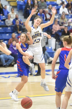 Mountain Home's Kate Gilbert has the ball stripped during a game earlier this season. The Bombers and Lady Bombers traveled to West Memphis on Friday night.