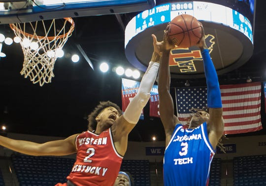 Louisiana Tech's Amorie Archibald (3) reels in the rebound while Western Kentucky's Jared Savage (2) attempts to knock it loose during the game at the Thomas Assembly Center in Ruston, La. on Jan. 26.