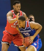 Louisiana Tech's Oliver Powell (35) drives the lane against Western Kentucky's Charles Bassey (23) during the game at the Thomas Assembly Center in Ruston, La. on Jan. 26.