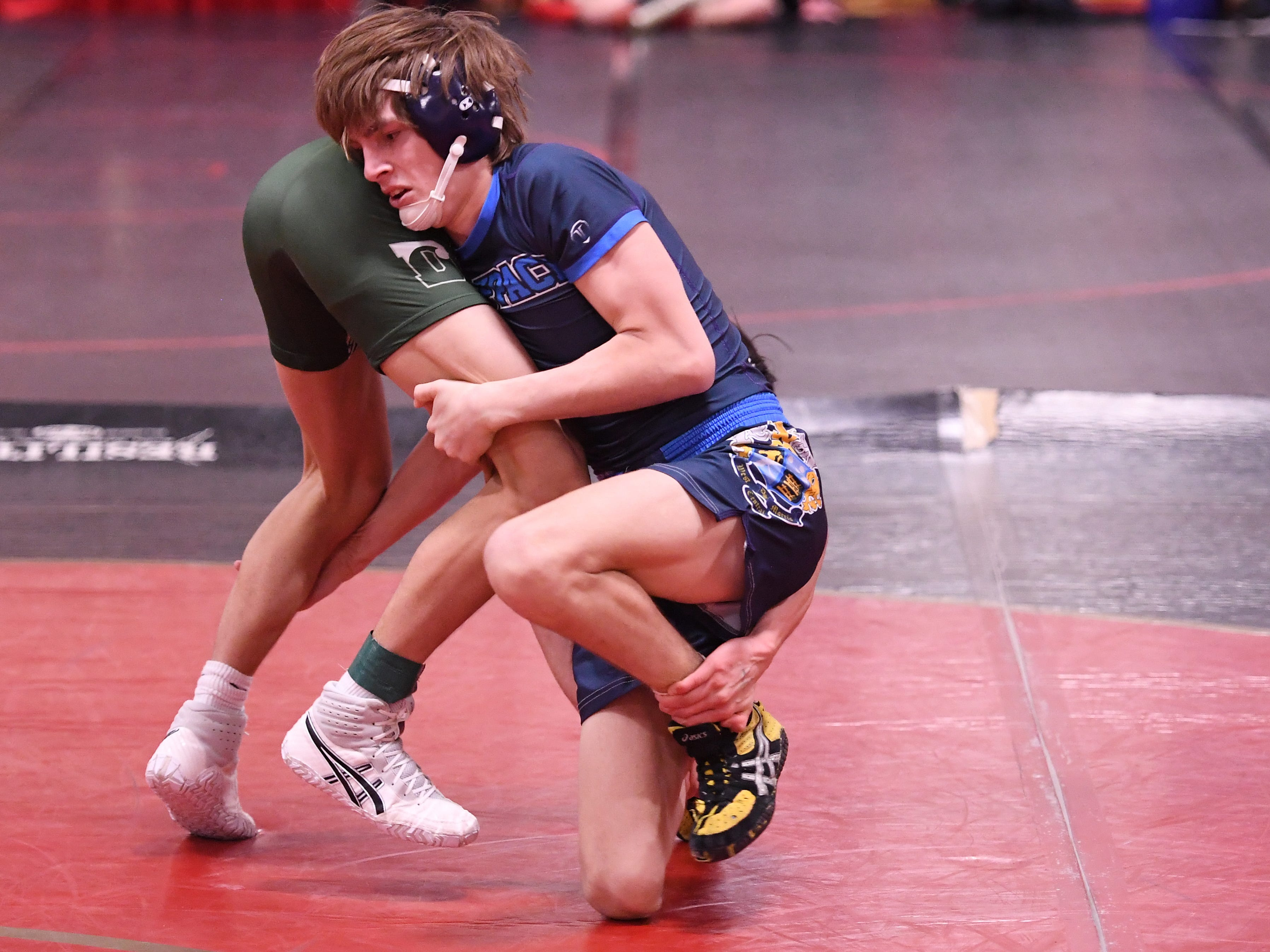 Eli Shepard of West Morris on his way to defeating Jack Sharma of Delbarton in their 132-pound match at the Morris County Tournament wrestling opening round at  Mount Olive High School on Friday, January 25, 2019.