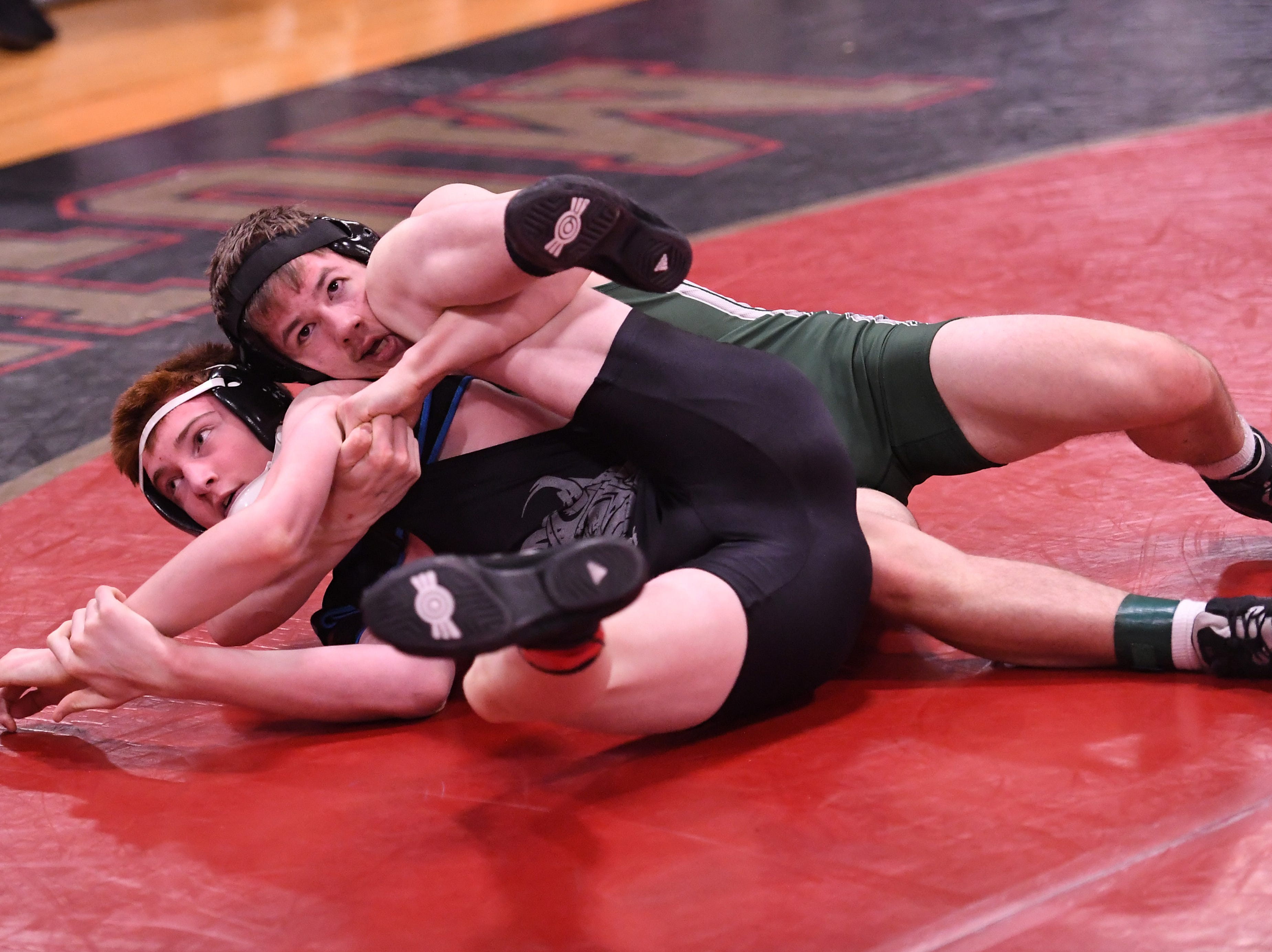 Morris County Tournament wrestling opening round at  Mount Olive High School on Friday, January 25, 2019. Ethan Harriz of Kinnelon on his way to defeating Joseph Parente of Parsippany Hills in their 138 pound match.