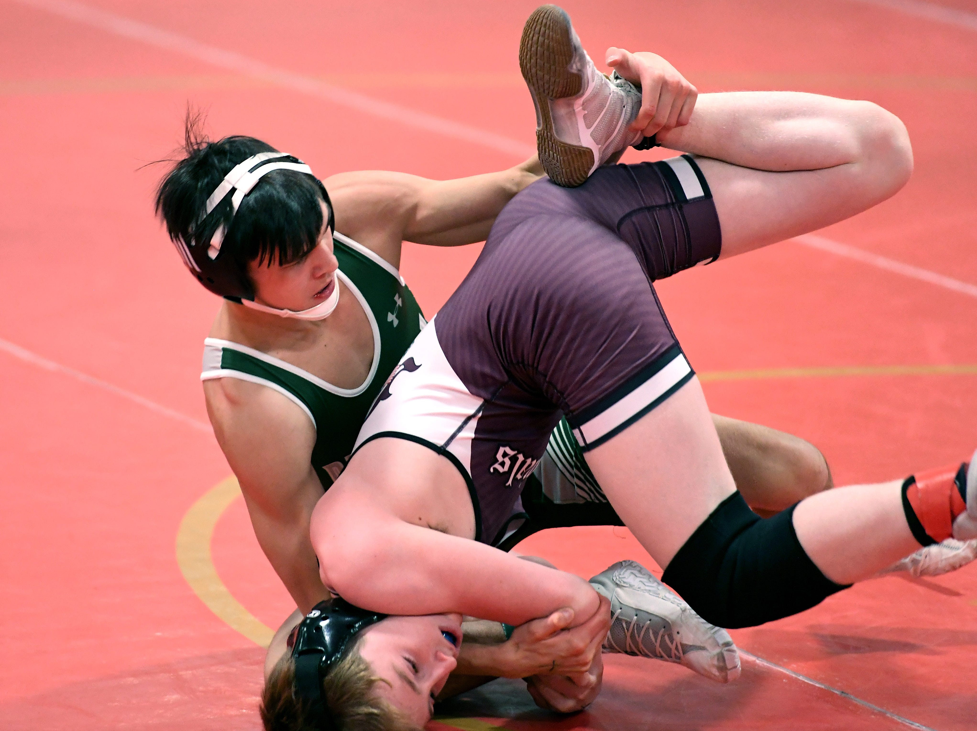 Jack Sharma of Delbarton competes against Shane O'Neill of Morristown in their 132-pound match at the Morris County Tournament wrestling opening round at  Mount Olive High School on Friday, January 25, 2019.