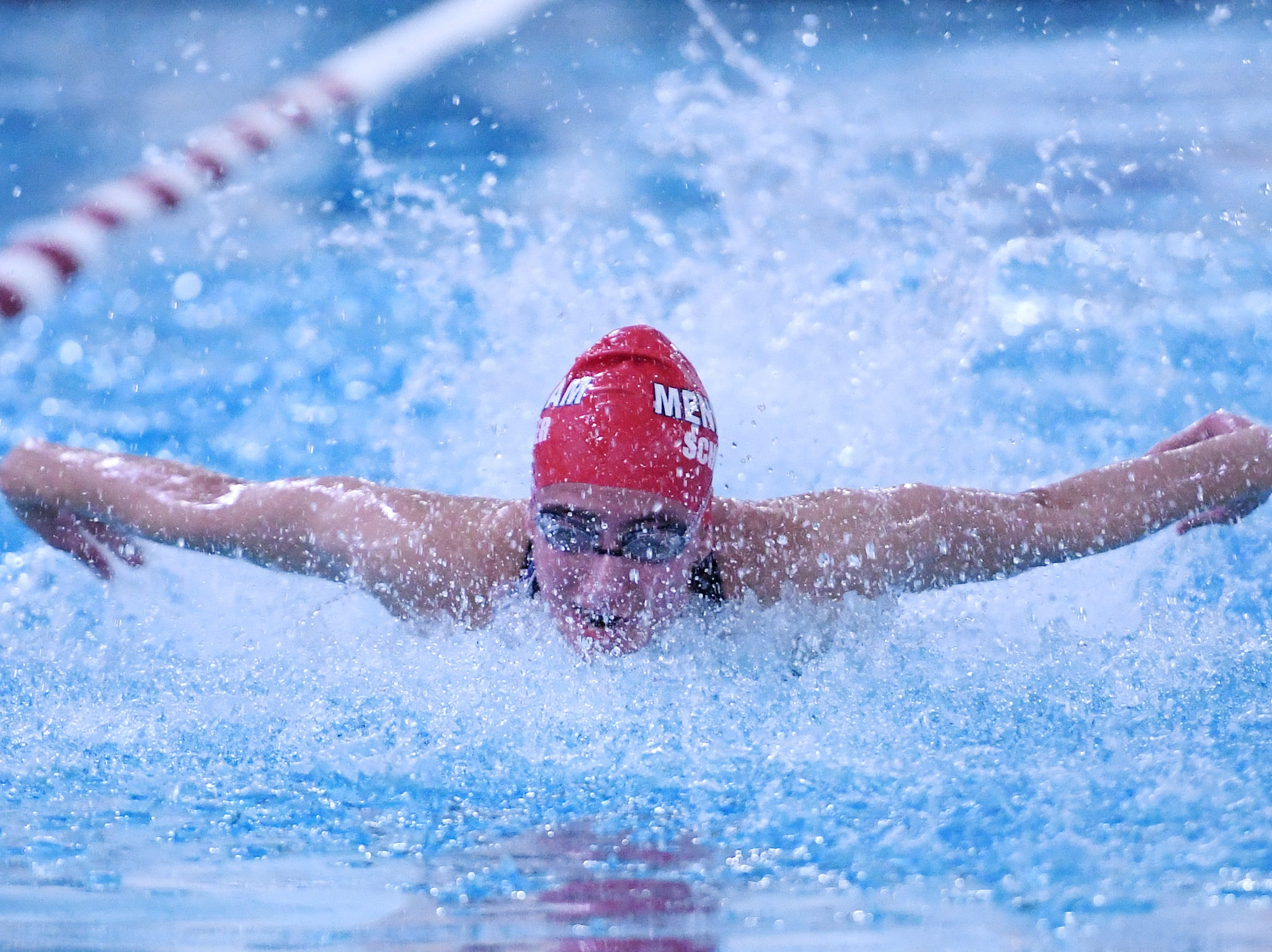 Aanika Schueler of Mendham swims the 100-meter butterfly during the Morris County Championships at Morristown High School on Saturday, January 26, 2019.