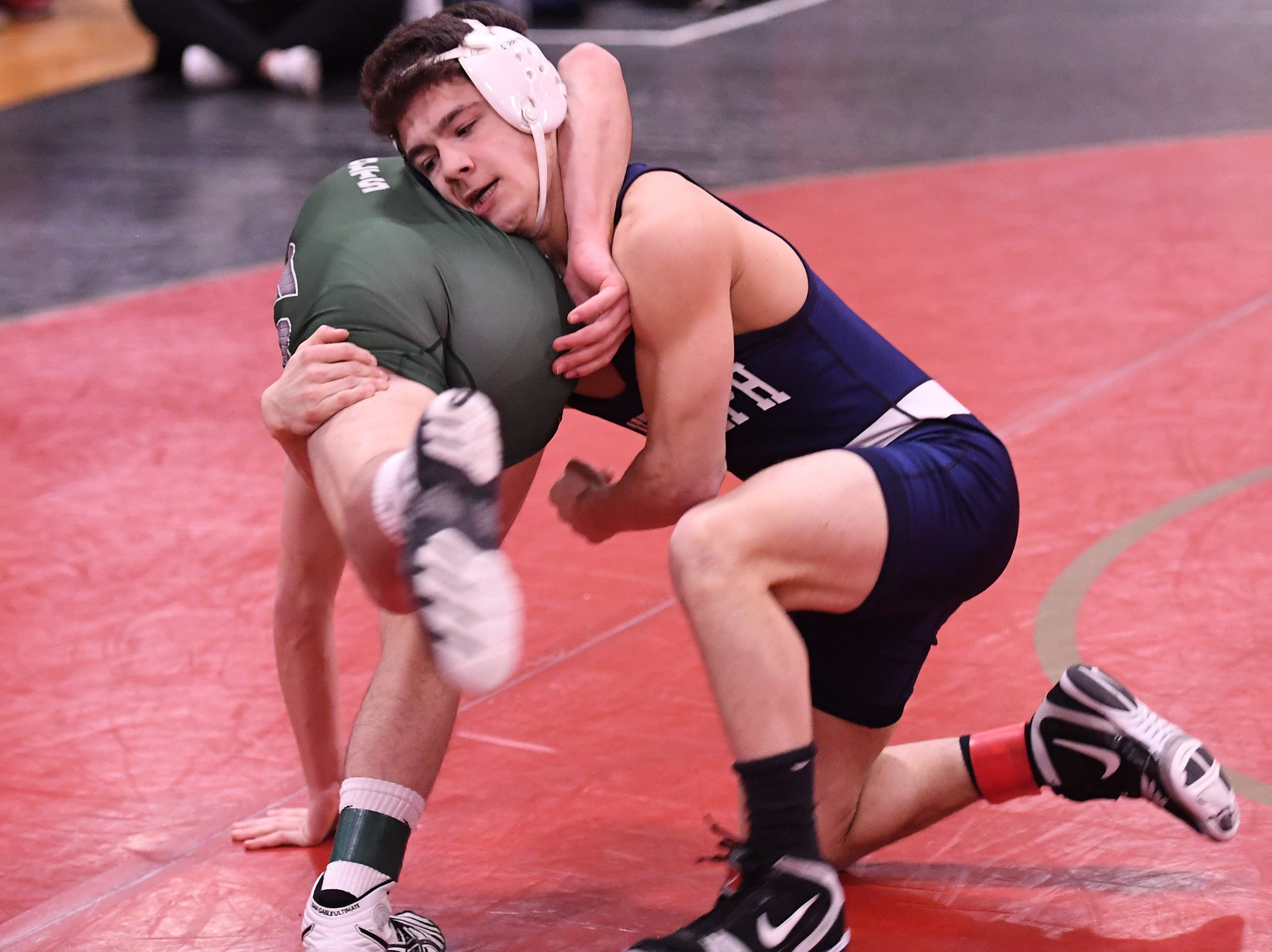 Morris County Tournament wrestling opening round at  Mount Olive High School on Friday, January 25, 2019. (right) Anthony Viespoli of Randolph vs. Christopher DiRubba of Kinnelon in their 132 pound match.