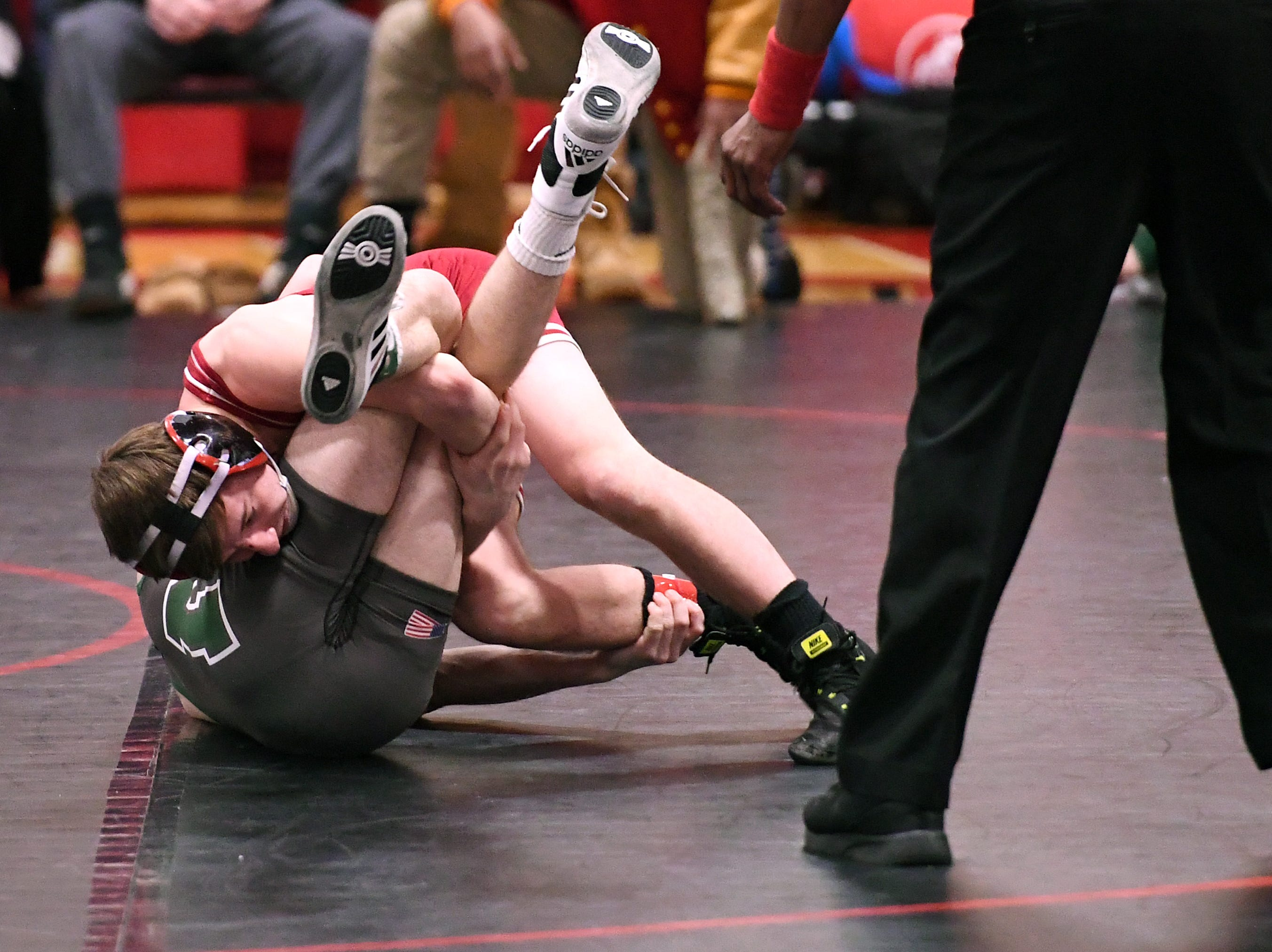Morris County Tournament wrestling opening round at  Mount Olive High School on Friday, January 25, 2019. (top) Alan Haynes of Whippany Park vs. Luke DeFillippo of Montville in their 120 pound match.