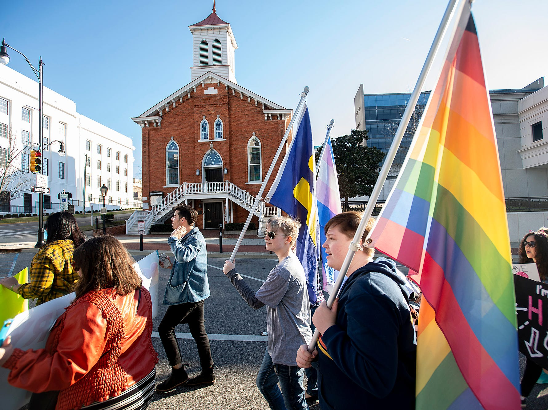 Marchers walk up Dexter Avenue, past the Dexter Avenue King Memorialk Baptist Church, to the State Capitol Building during the Montgomery Women's March in downtown Montgomery, Ala., on Saturday January 26, 2019.