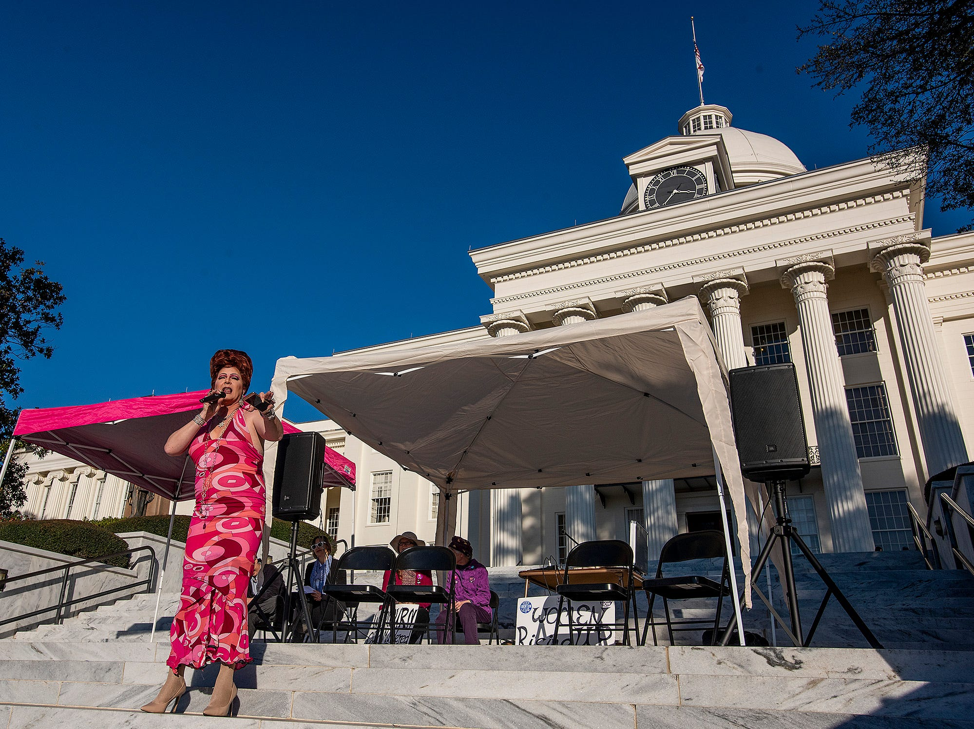 Ambrosia Starling acts as emcee on the capitol steps during the Montgomery Women's March in downtown Montgomery, Ala., on Saturday January 26, 2019.
