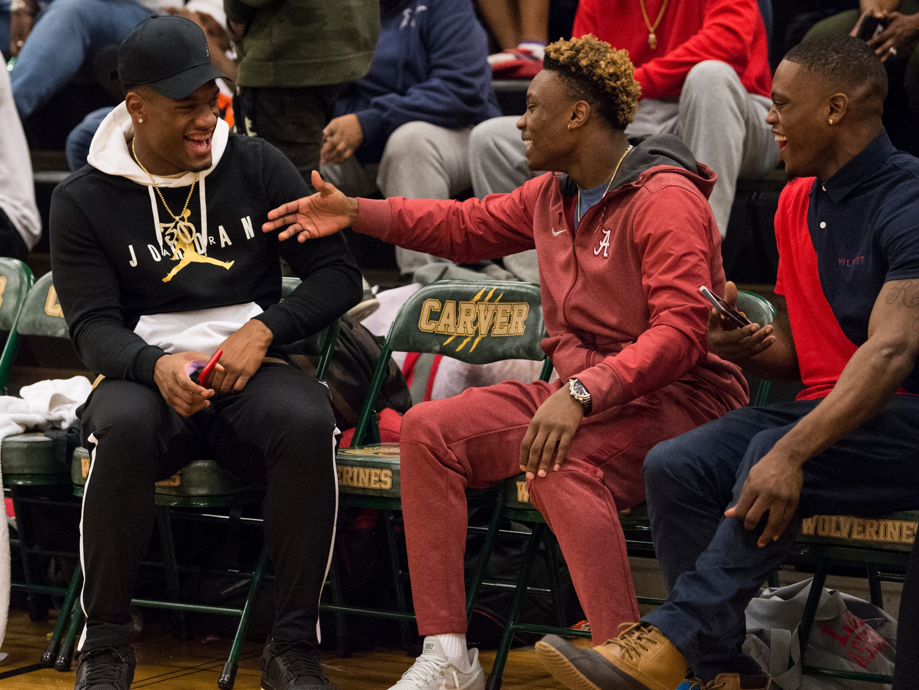 Carver grad Mack Wilson and Lee grad Henry Ruggs III both Alabama football players joke on the sideline of the Carver-Lee basketball game at Carver High School in Montgomery, Ala., on Friday, Jan. 25, 2019. Lee defeated Carver 57-50.