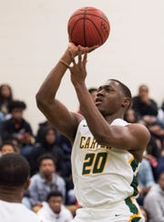 Carver forward Jereme Robinson (20) goes up for a layup at Carver High School in Montgomery, Ala., on Friday, Jan. 25, 2019. Lee defeated Carver 57-50.