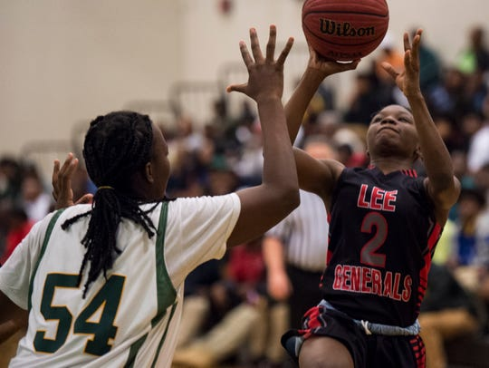 Lee's Tyasia Brown (2) takes a shot over Carver's Alia Jordan (54) at Carver High School in Montgomery, Ala., on Friday, Jan. 25, 2019. Carver defeated Lee.