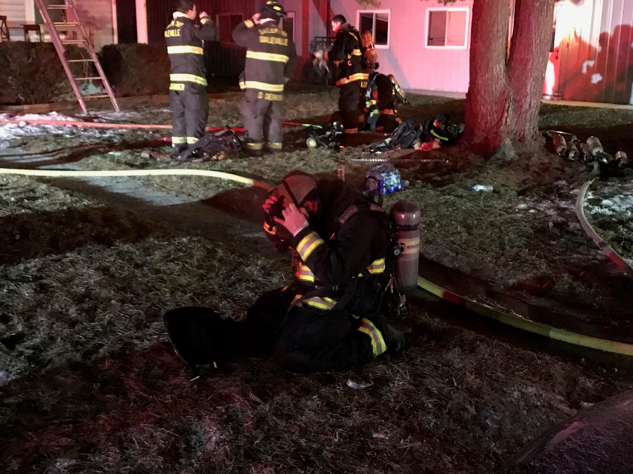Firefighters from Yorktown and other area departments late Friday battled a blaze, while contending with snow and frigid temperatures, in a house containing four apartments in the unincorporated community of Cammack.