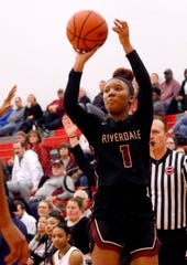 Riverdale's Alasia Hayes fires a shot during a 2019 game. Hayes signed with Notre Dame Wednesday.