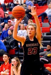Riverdale's Jalyn Holcomb (23) attempts a three point basket against Stewart Creek on Friday Jan. 25, 2019.