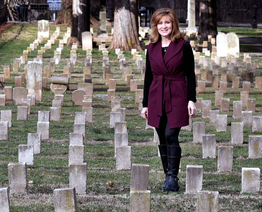 A historical fiction author Tamera Alexander has started a new trilogy series with Harper Collins on Carnton in Franklin, Tennessee. Alexander stands in McGavock Confederate Cemetery which is the focus of her next book.