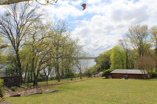 A view of the yard and the lake beyond at Johnny Cash's former estate, which has just been listed for $3.95 million.