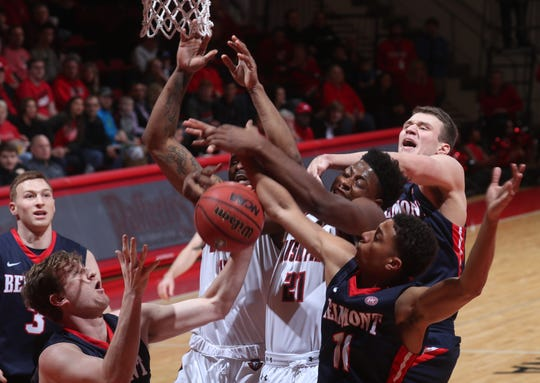 Austin Peay's Terry Taylor (21) battles Belmont's Kevin McClain for a rebound during OVC action Saturday at the Dunn Center.