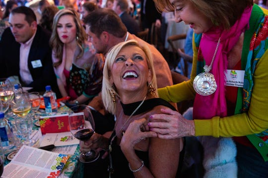 Becky Card is embraced by Linda Richards Malon during the auction at the Naples Winter Wine Festival, held at the Ritz-Carlton Golf Resort on January 26, 2019.