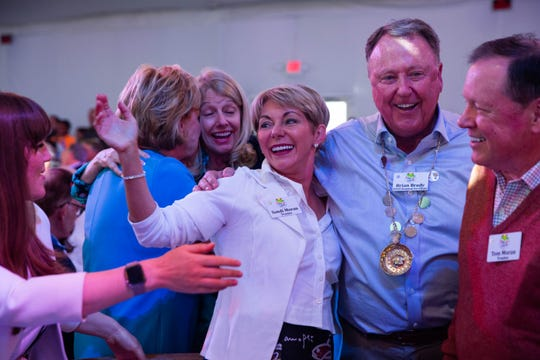"Sandi Moran celebrates after placing a winning bid on lot-10, ""The Greatest Two Minutes in Sports,"" at the Naples Winter Wine Festival on January 26, 2019. Moran secured the bid with $250,00."