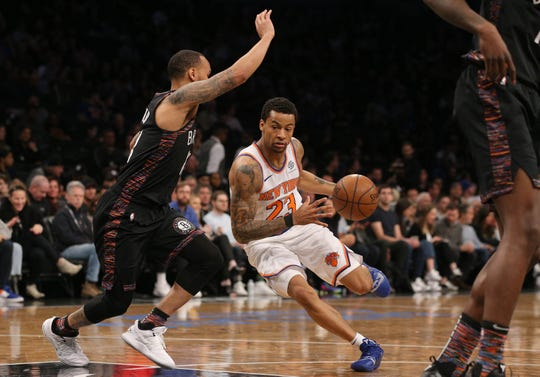 Jan 25, 2019; Brooklyn, NY, USA; New York Knicks guard Trey Burke (23) drives against Brooklyn Nets point guard Shabazz Napier (13) during the second quarter at Barclays Center.