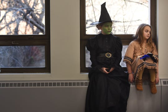 Phoebe Mazone, 8 dressed as the Wicked Witch from 'The Wizard of Oz' and Charlotte Ersalesi, 8 dressed as She Who is Alone from 'The Legend of the Bluebonnet' for the Literary Character Contest at Rutherford Library in Rutherford on Saturday January 26, 2019.