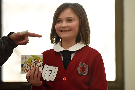 Nina Tavani, 9 dressed as Violet dressed as Violet Baudelaire from the book 'A Series of Unfortunate Events' during the Literary Character Contest at Rutherford Library in Rutherford on Saturday January 26, 2019.