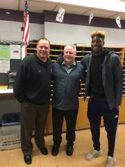Wayne Hills football coach Wayne Demikoff, UCLA coach Chip Kelly and Charles Njoku, taken Jan. 24 at Wayne Hills High School.