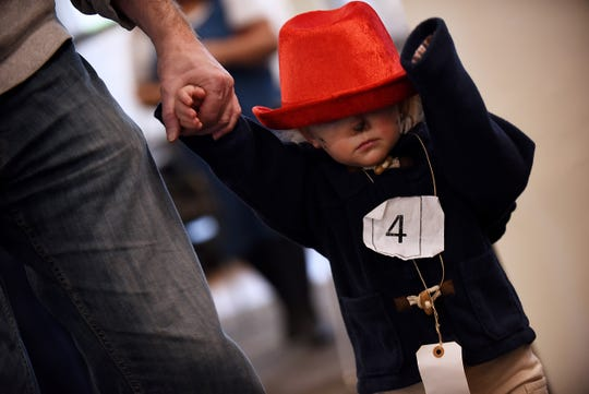 Zachary Conforti, 18 months old dressed as Paddington Bear adjusts his hat during the Literary Character Contest at Rutherford Library in Rutherford on Saturday January 26, 2019.