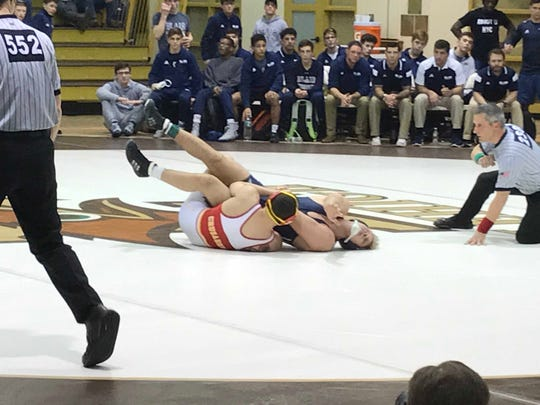 Chris Foca of Bergen Catholic gets back points in his match at Lehigh against Peyton Craft of Blair Academy