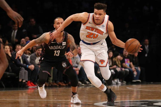 Jan 25, 2019; Brooklyn, NY, USA; New York Knicks forward Kevin Knox (20) controls the ball against Brooklyn Nets point guard Shabazz Napier (13) during the first quarter at Barclays Center.