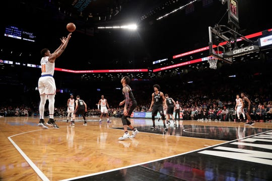 New York Knicks' Frank Ntilikina (11) shoots over Brooklyn Nets' D'Angelo Russell during the first half of an NBA basketball game Friday, Jan. 25, 2019, in New York.