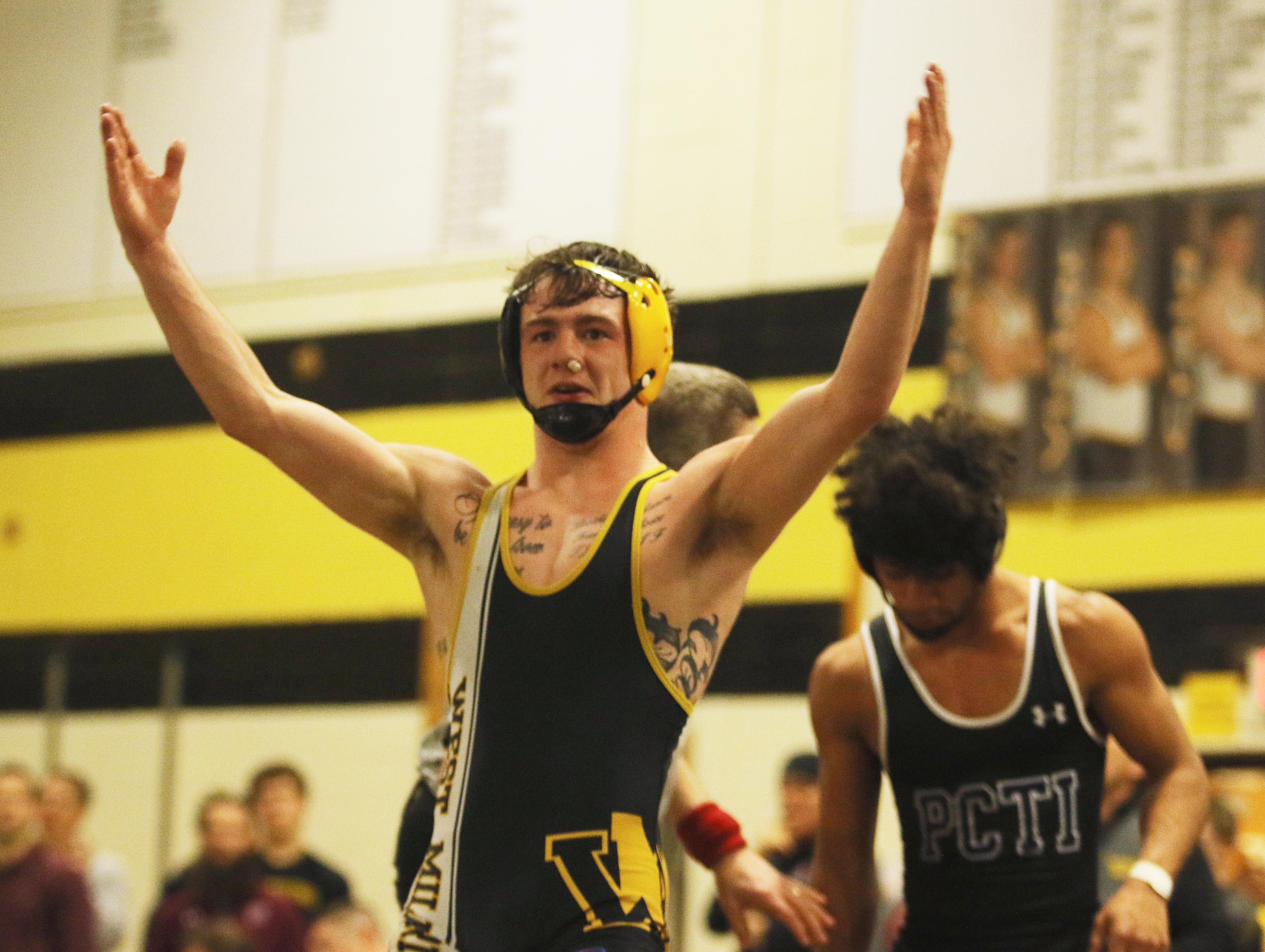 Trevor Fleet of West Milford after he defeated Christian Vertedor of Passaic Tech in the 132 lb. match. in the 132 lb. match.