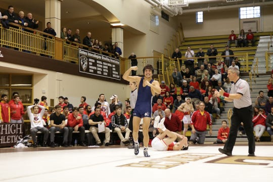 Blair Academy 145-pounder Josh Gobencion flexes after his victory over Nate Camiscoli.