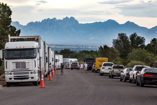 "Production trucks are parked on a street in the Picacho Hills during the filming of ""The Mule."""