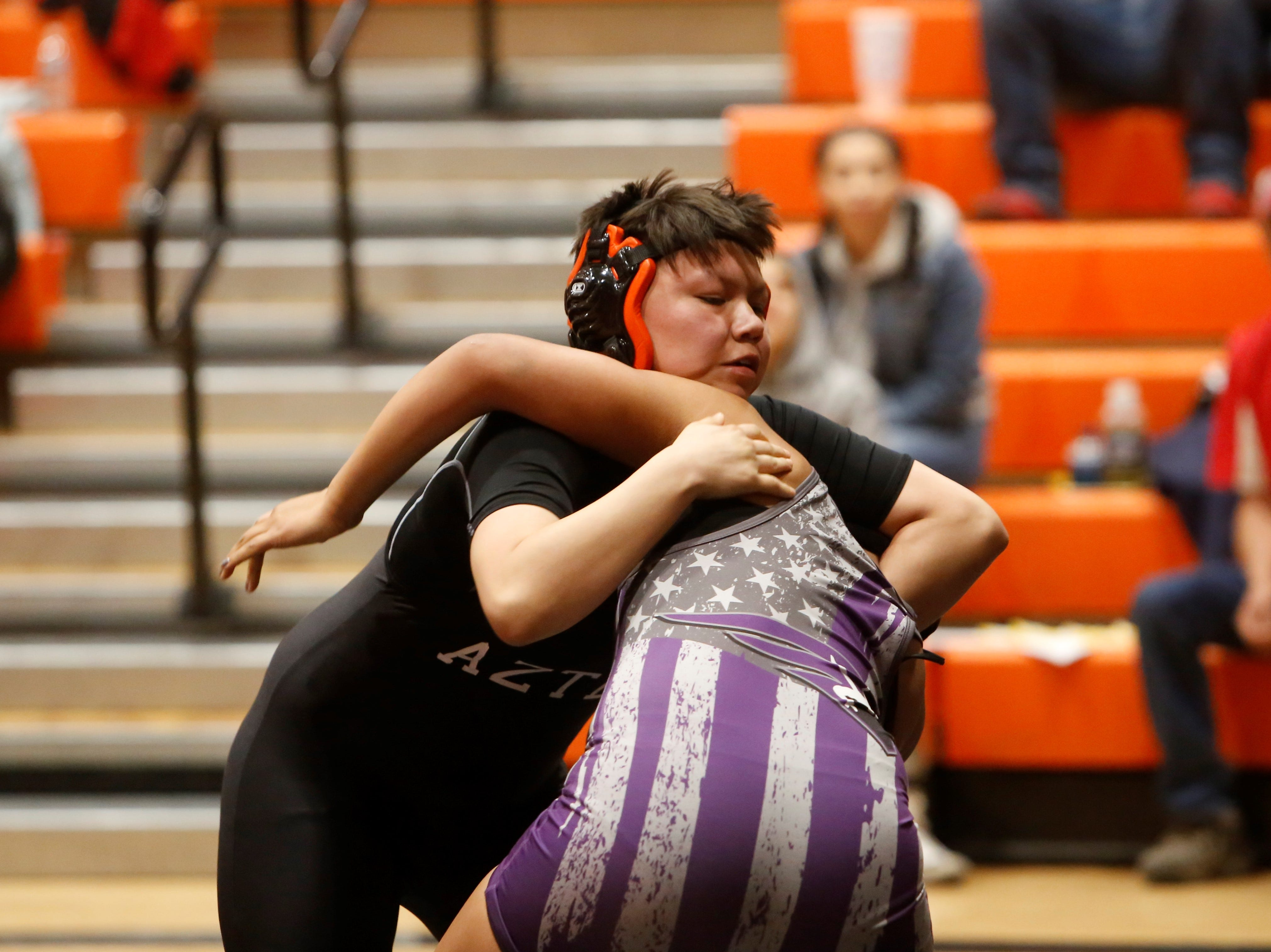 Aztec's Princess Altisi looks to take Miyamura's Nancy Rodriguez to the ground in a 160-pound division match during during Friday's first annual girls wrestling tournament in Aztec. Rodriguez won the 160-pound title, while Altisi took second.