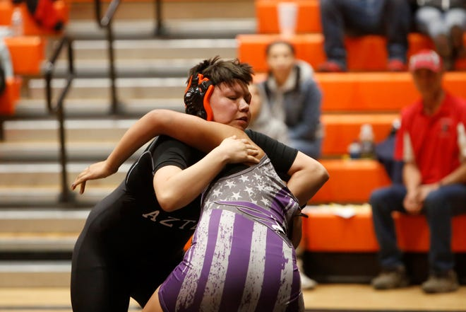 Aztec's Princess Altisi looks to take Miyamura's Nancy Rodriguez to the mat in a 160-pound division match during Friday's inaugural girls wrestling tournament in Aztec. Rodriguez won the 160-pound title, while Altisi took second.