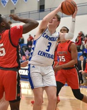 Catholic Central's David Lukomski (3) goes up for the shot against St. Mary Prep's Anthony Enechukwu.
