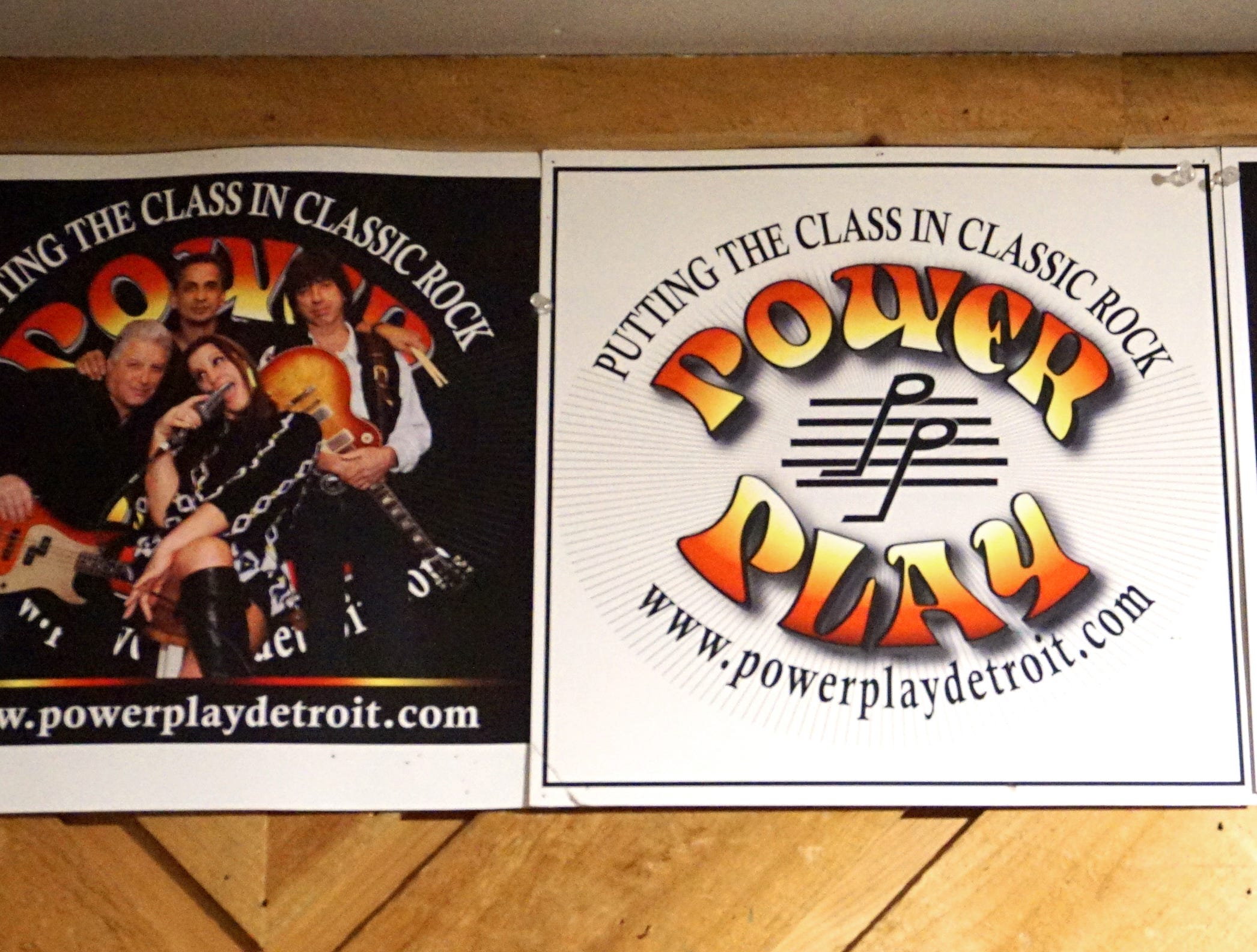 In their studio-garage-practice space Power Play has some of their promotional posters up on the wall.