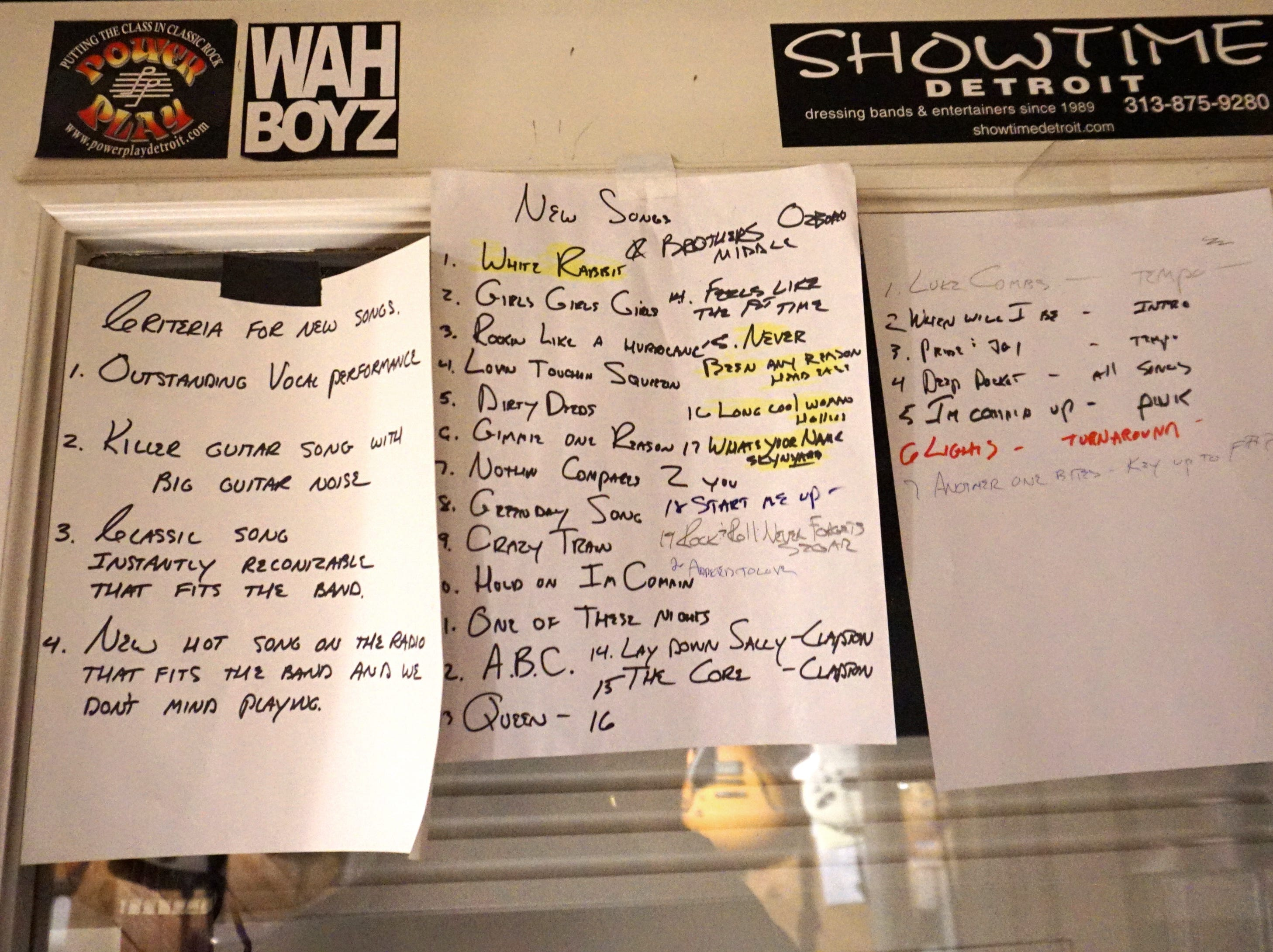 "Printouts of some of Power Play's song lists and their ""Criteria for New Songs"" adorn the walls of their Livonia studio."