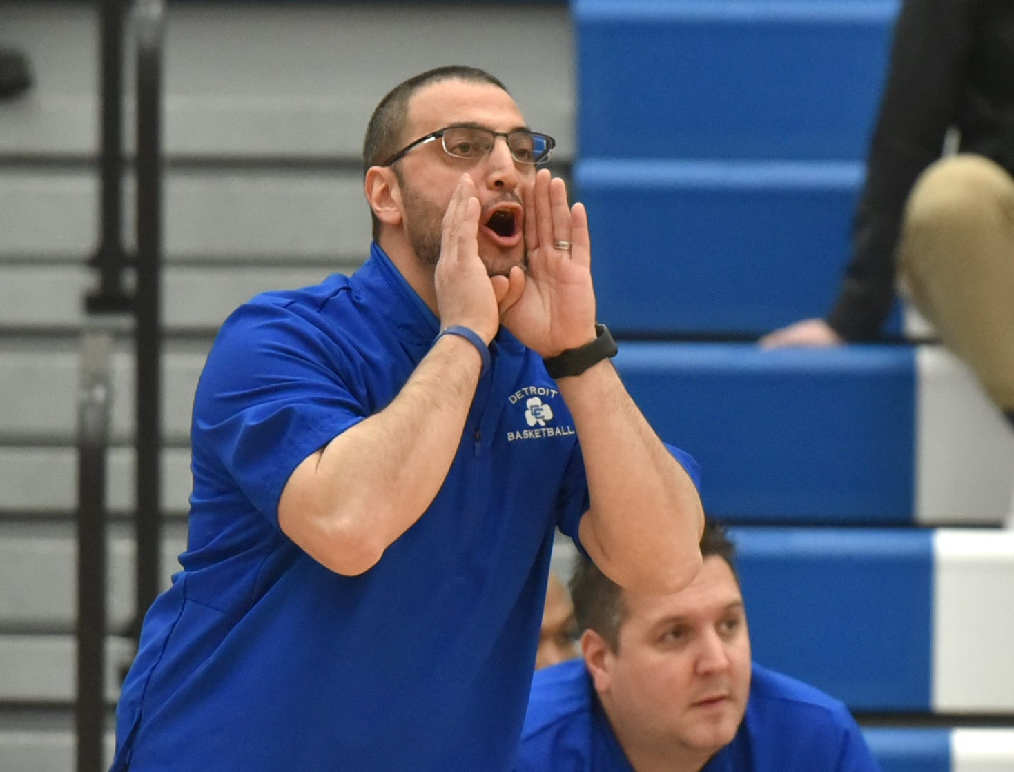 Detroit Catholic Central head coach Brandon Sinawi yells some instructions to his Shamrock varsity team.