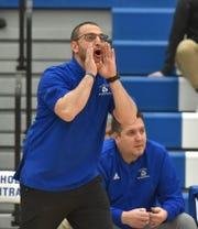 Detroit Catholic Central head coach Brandon Sinawi yells some instructions to his Shamrock varsity team.
