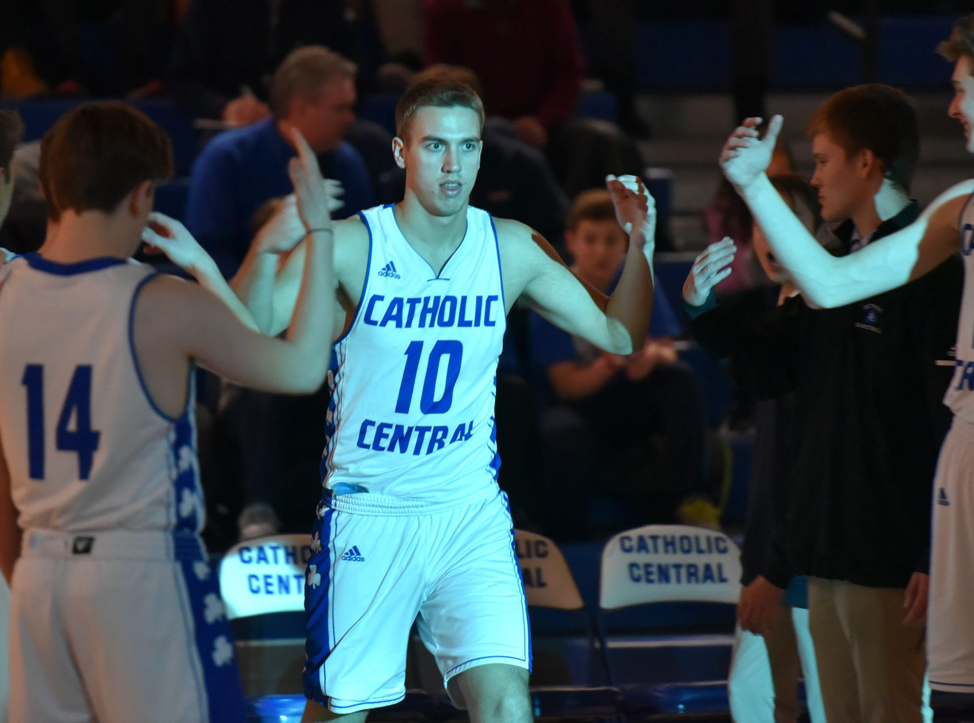 Shamrock Mike Harding is introduced to the Catholic Central gymnasium.