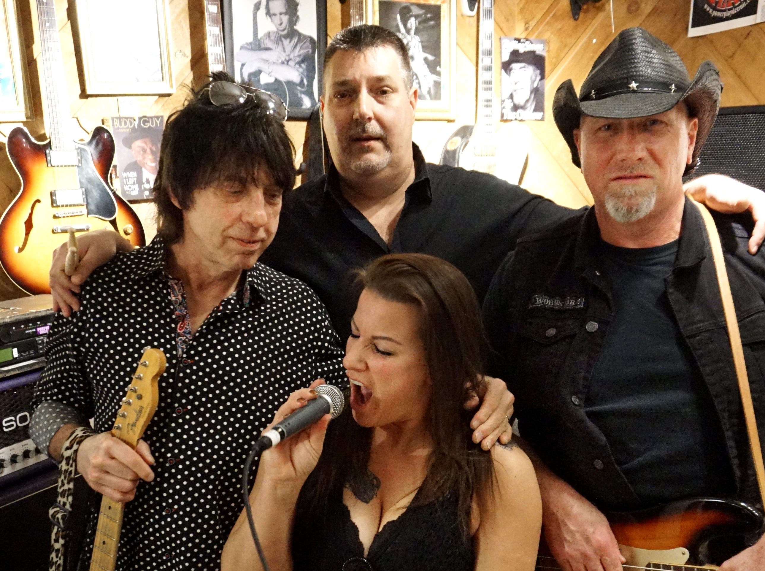 Power Play has some fun their studio on a Friday night. From left guitarist Michael Smith, drummer Bob Olds, singer April Hudson, and bassist Gary Kosten.