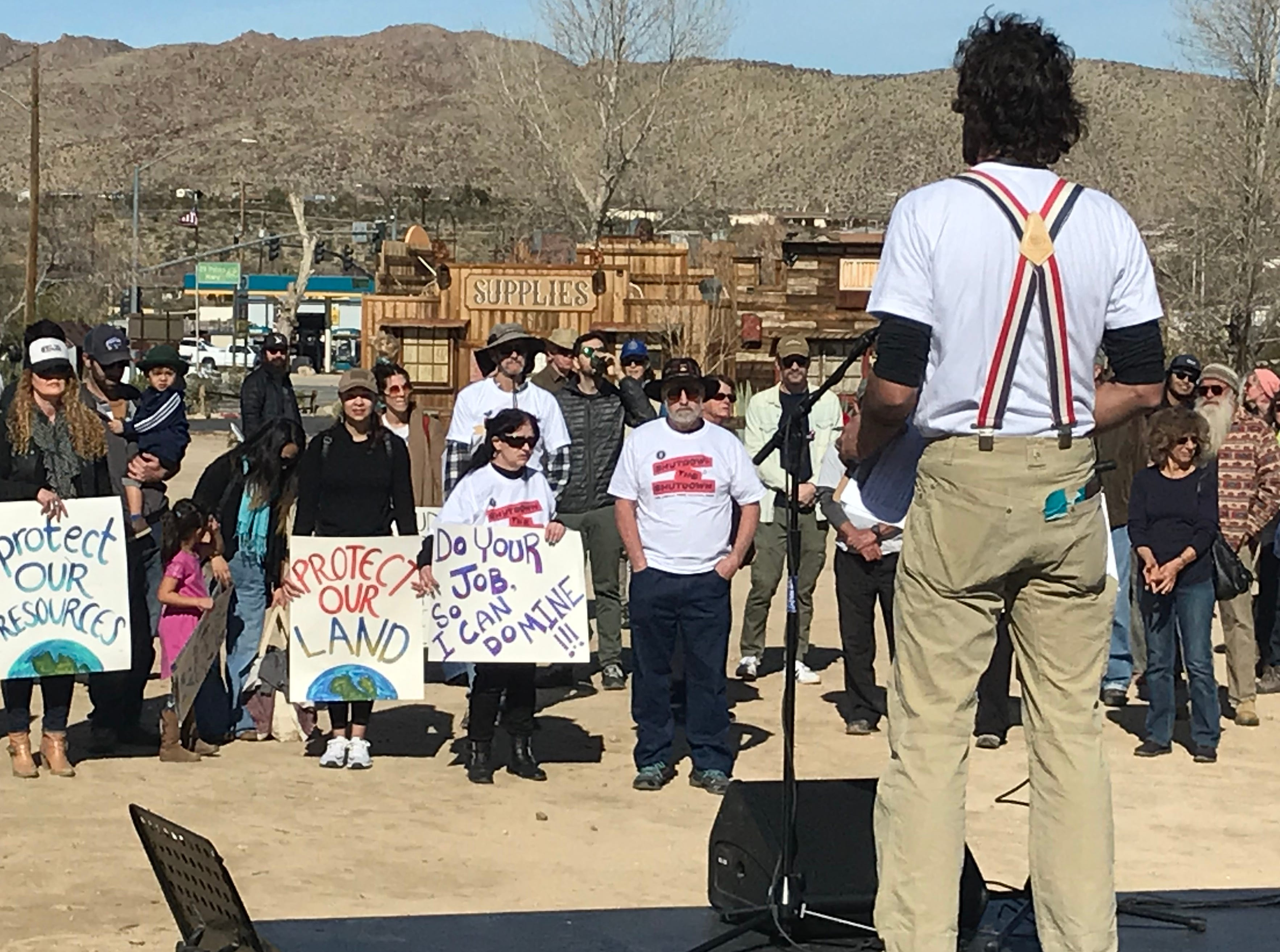 "Volunteer Travis Puglisi speaks to more than 100 people on Saturday, Jan. 26, at the ""Assembly to Shutdown the Shutdown for Joshua Tree National Park"" event in Joshua Tree."