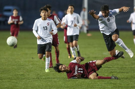 Jorge Ochoa of Rancho Mirage, 11, lands hard after a header while being Julian Benitez of Palm Springs, 6, tries to avoid the collision, January 25, 2019.